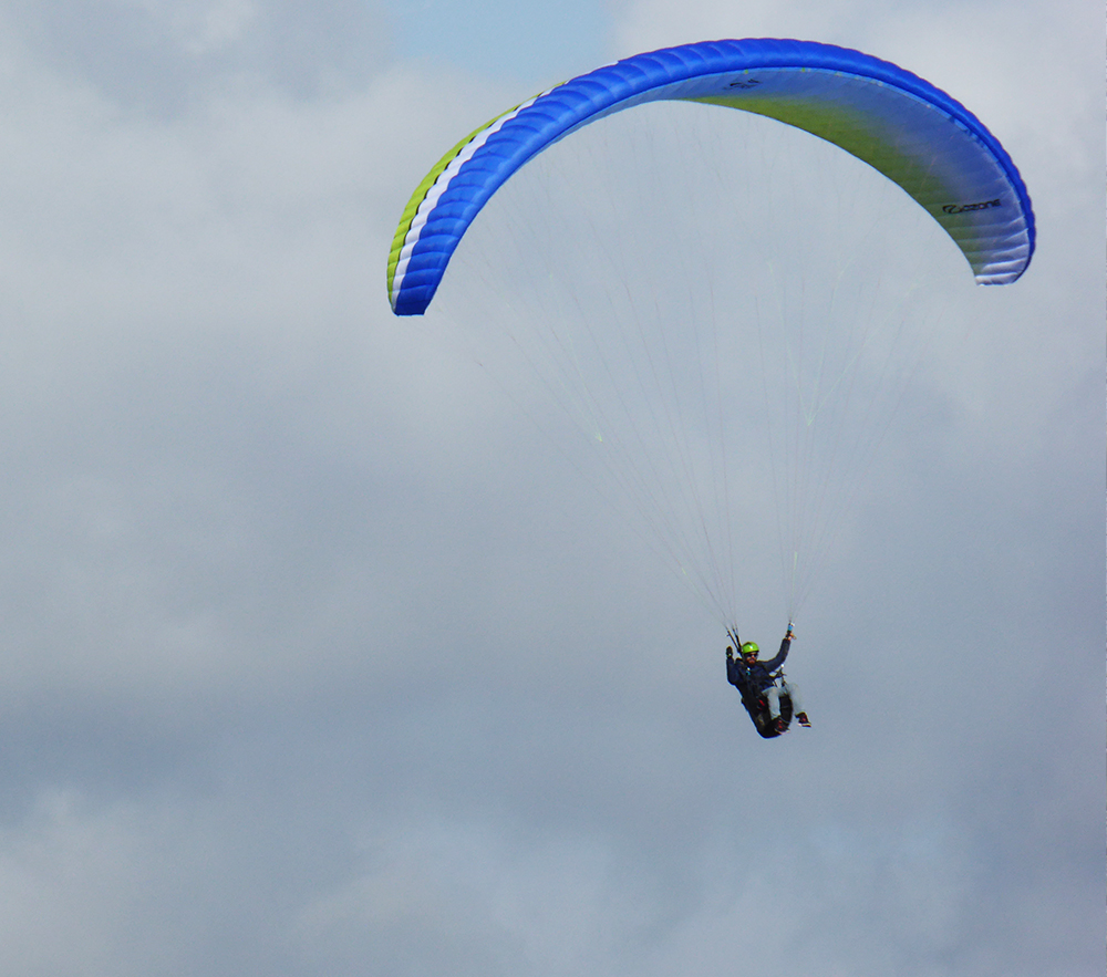 A paraglider floating over the white horse